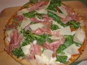 Pizza with Prosciutto, Arugula, and Shaved Parmesan